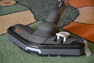 Vacuumming the carpet before the spring