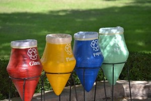 Four main colours of recycling bins - red, yellow, blue and green